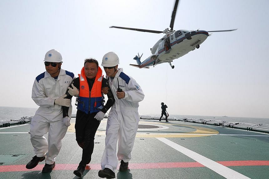 Tuesday's maritime rescue exercise simulated a collision between a Chinese passenger ship and a Cambodian cargo vessel off the coast of Guangdong province in south China.