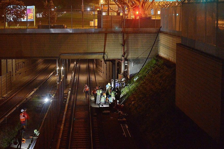Operations to remove sludge from tunnels beneath the tracks at Bishan MRT station.