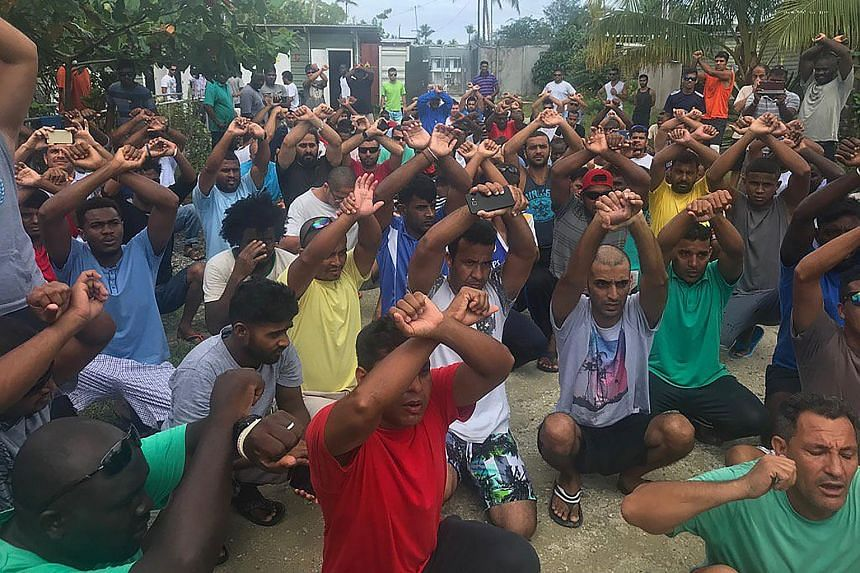 "Refugees in Papua New Guinea's Manus Island detention camp protesting on Tuesday when they learnt of the camp's imminent closure that day. The picture was taken by Senator Nick McKim, an Australian Greens MP representing Tasmania. Hundreds of ""scared"