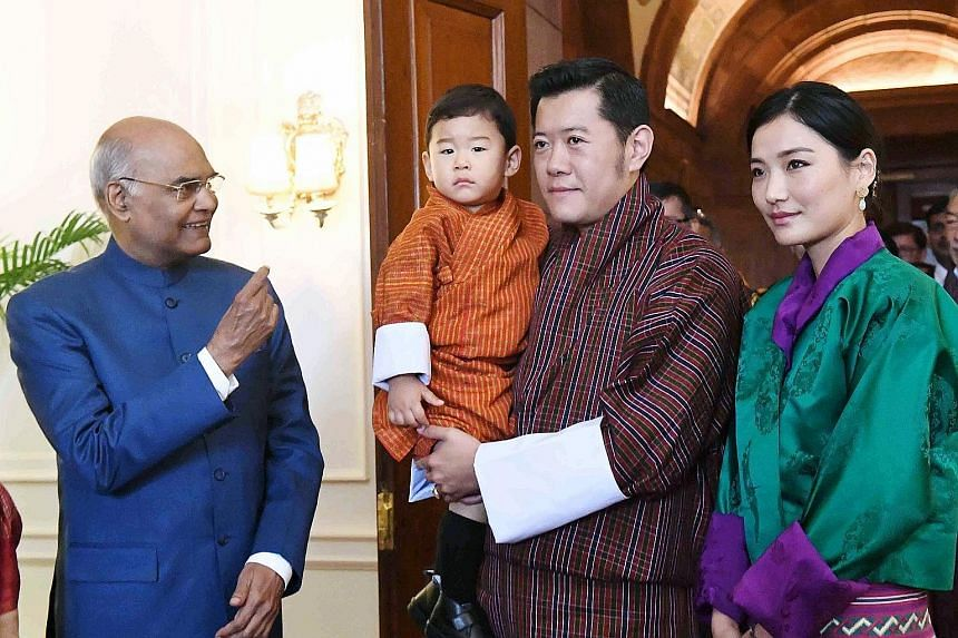 Indian President Ram Nath Kovind (far left) is shown meeting Bhutan's King Jigme Khesar Namgyel Wangchuck, Queen Jetsun Pema and Prince Jigme Namgyel at Rashtrapati Bhavan in New Delhi in a photograph released by the President's office yesterday. The