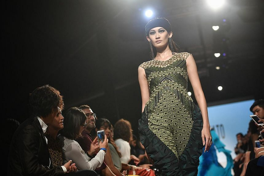 Designs showcased at Singapore Fashion Week include those from Singapore's Adrianna Yariqa (top), Japan's Zin Kato (above) and Malaysia's Bill Keith (below).