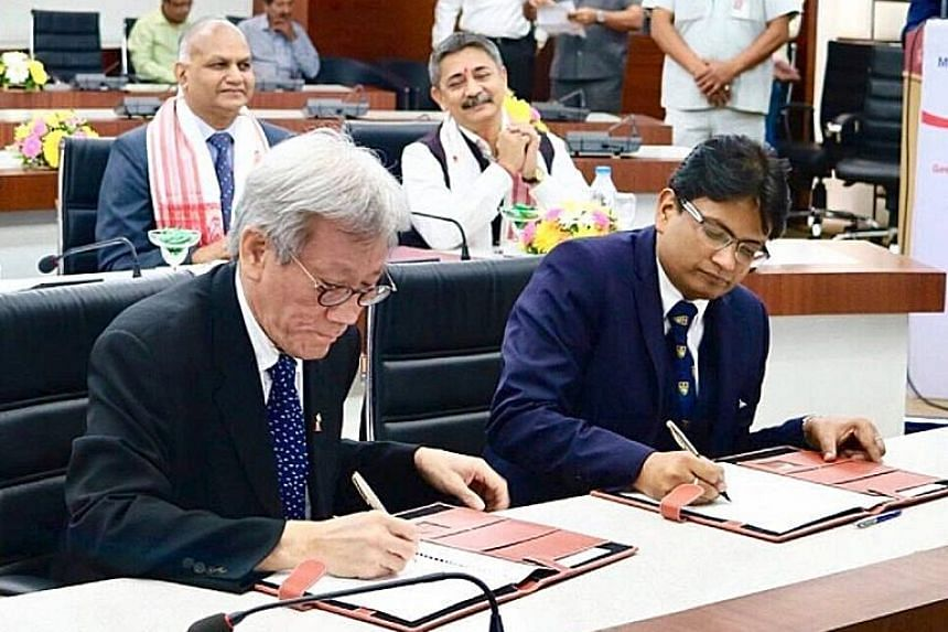 Singapore High Commissioner Lim Thuan Kuan and Assam state government principal secretary Ashutosh Agnihotri signing the MOU to set up the skills centre in Guwahati.
