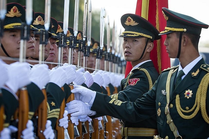 Soldiers of the Chinese People's Liberation Army honour guard preparing for a welcome ceremony for Russian Prime Minister Dmitry Medvedev at the Great Hall of the People in Beijing yesterday. Mr Medvedev is on a visit to China from Tuesday to today.