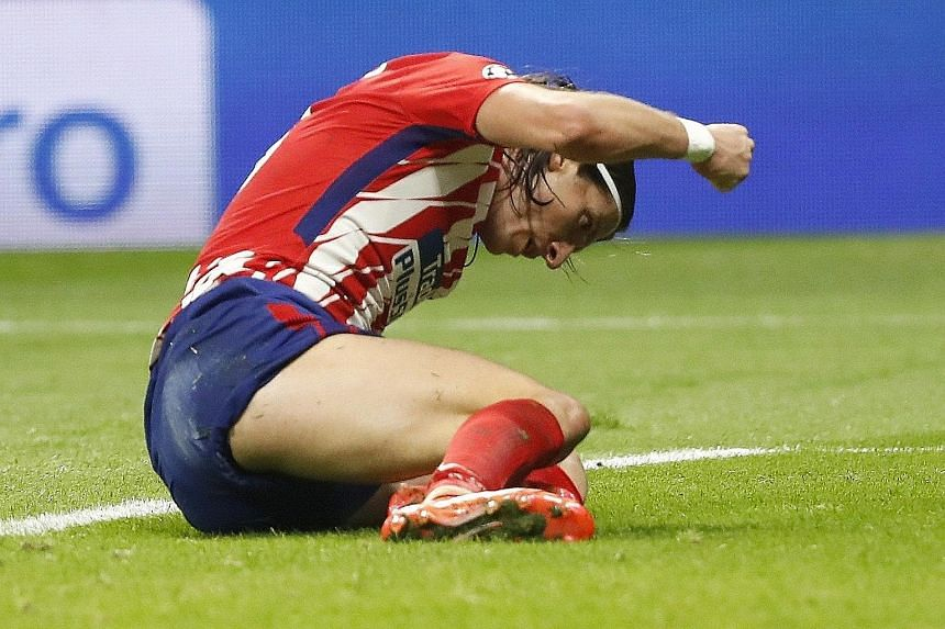 Atletico Madrid defender Filipe Luis reacting in frustration as another chance went begging against Qarabag on Tuesday. The Spanish side's chances of progressing to the Champions League knockout stages are slim.