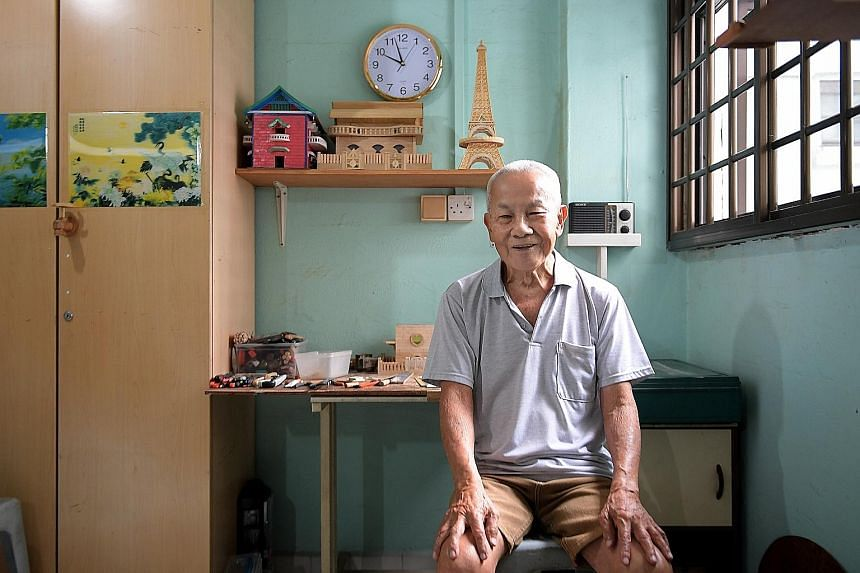 Mr Sum takes about three to four months to build a miniature house from plywood. So far, he has built more than 10 houses and sold a few for over $100 each. To pass time, retired carpenter Sum Kin Nar started building miniature houses about 10 years