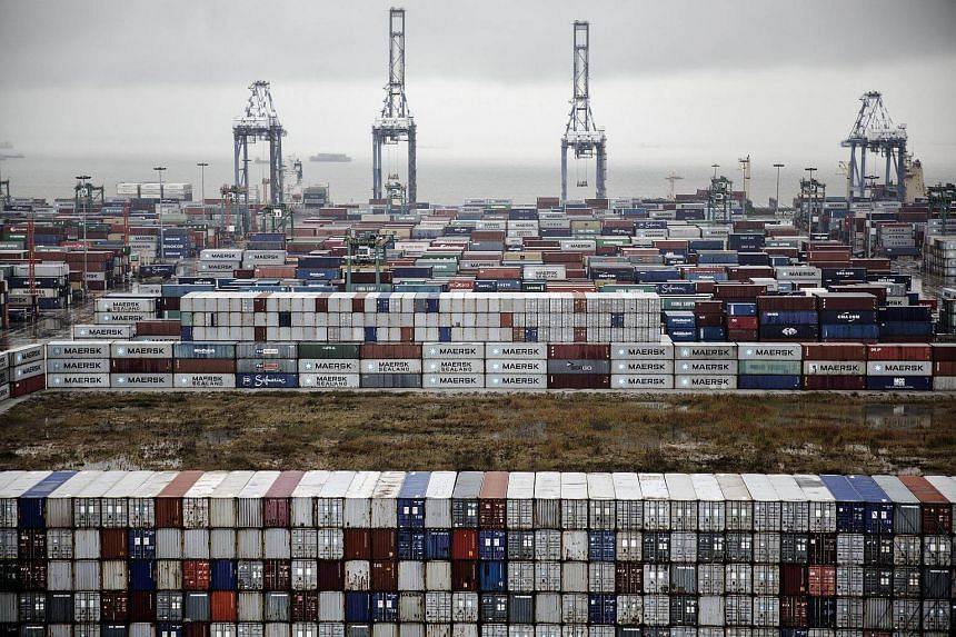 Shipping containers stacked at the Guangzhou Nansha Container Port in China.