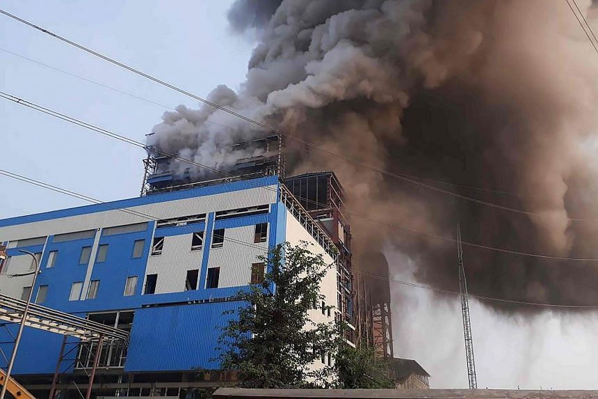 Smoke billows from a coal-fired power plant after a boiler unit exploded in the town of Unchahar in the northern Indian state of Uttar Pradesh.