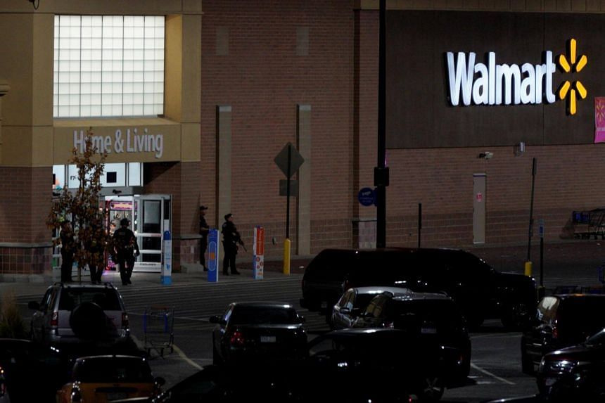 Police guard the entrance at the scene of a shooting at a Walmart in Thornton, Colorado.