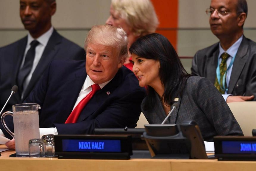 US President Donald Trump and US Ambassador to the UN Nikki Haley speak during a meeting on United Nations Reform at the United Nations.