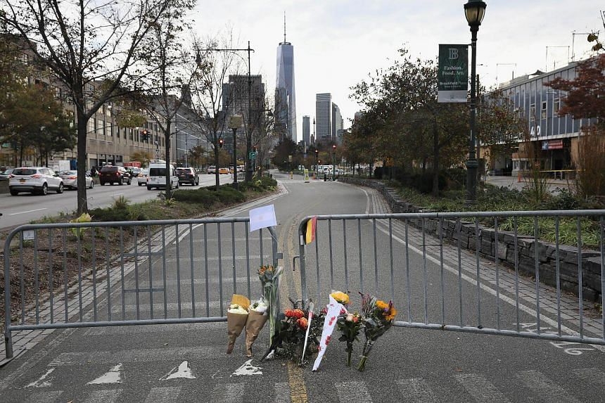 A makeshift memorial stands on a bike path in lower Manhattan, where eight people were killed and 12 injured when suspect 29-year-old Sayfullo Saipov intentionally drove a truck onto the path.