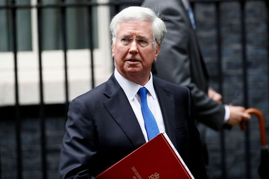 Britain's Secretary of State for Defence Michael Fallon leaves 10 Downing Street after a cabinet meeting, in London.