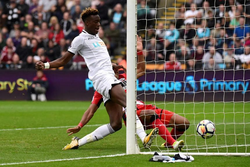 Swansea's Tammy Abraham scores their second goal against Huddersfield in the Premier League game at the Liberty Stadium on Oct 14, 2017.