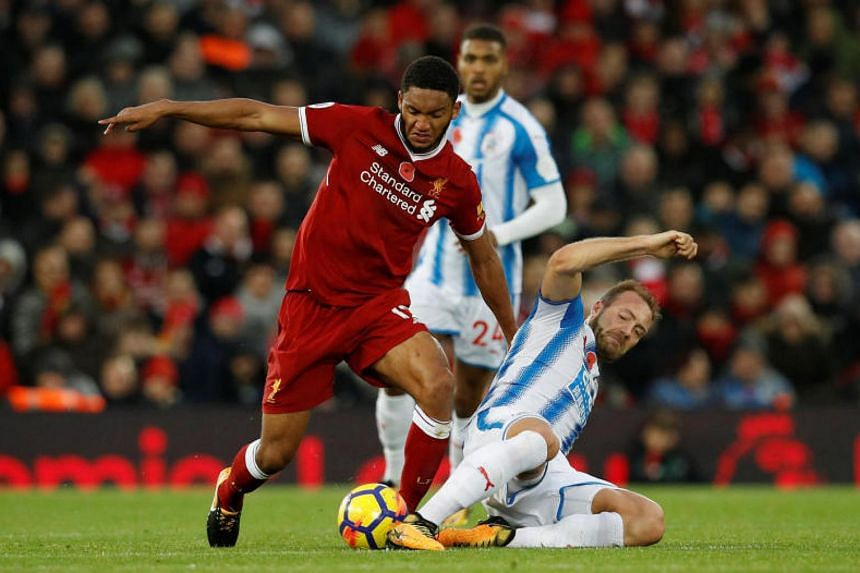 Liverpool's Joe Gomez in action with Huddersfield Town's Laurent Depoitre on Oct 28, 2017.