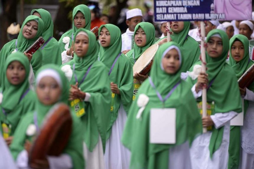 Indonesian students march in a parade marking the Islamic New Year in Banda Aceh on Sept 21, 2017.