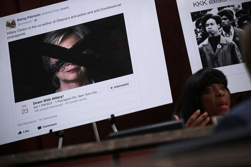 A print out of a social media post targeting former Democratic presidential candidate Hillary Clinton is on display as Rep. Terri Sewell (D-AL) speaks during a hearing before the House (Select) Intelligence Committee November 1, 2017 on Capitol Hill
