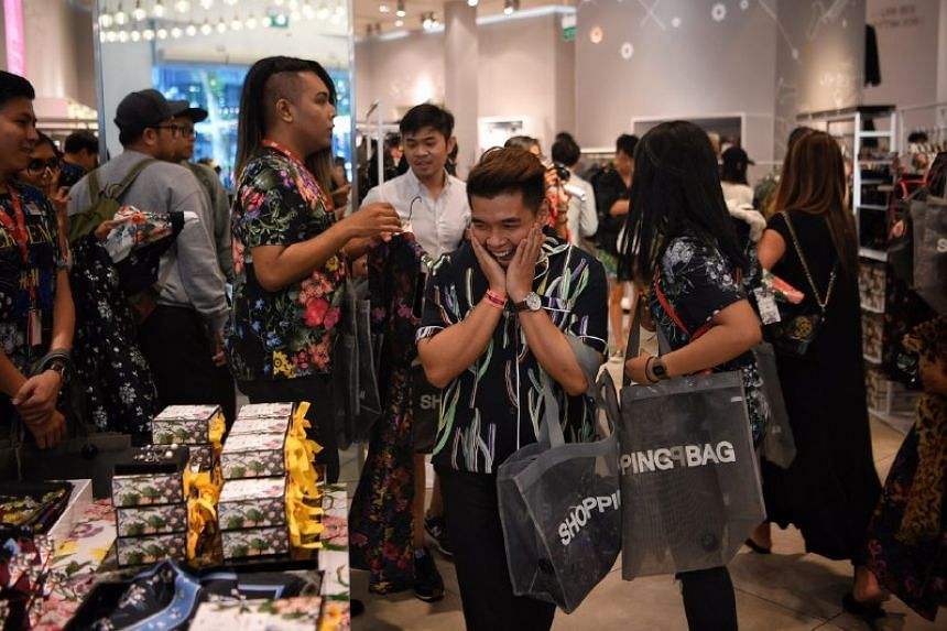 Diniy D Hamzah, 28, picks out products during the launch of the H&M X Erdem designer collaboration collection at H&M Orchard Building on Nov 2, 2017.