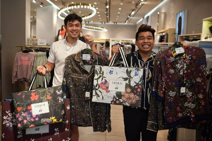 Afif Barker (left), 23 and Diniy D Hamzah, 28, pictured with their loot after the launch of the H&M X Erdem designer collaboration collection at H&M Orchard Building on Nov 2, 2017.
