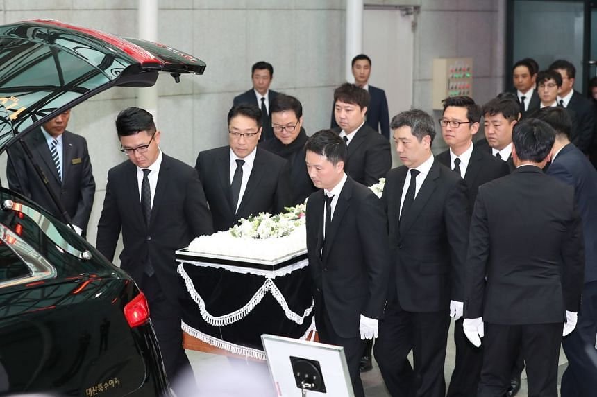Members of a funeral procession for the late South Korean actor Kim Joo Hyuk carry his portrait and coffin at the Asan Medical Center in Seoul, South Korea.