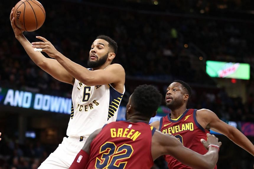 Cory Joseph of the Indiana Pacers tries to get a shot off between Jeff Green and Dwyane Wade of the Cleveland Cavaliers during the first half at Quicken Loans Arena in Cleveland, Ohio, on Nov 1, 2017.