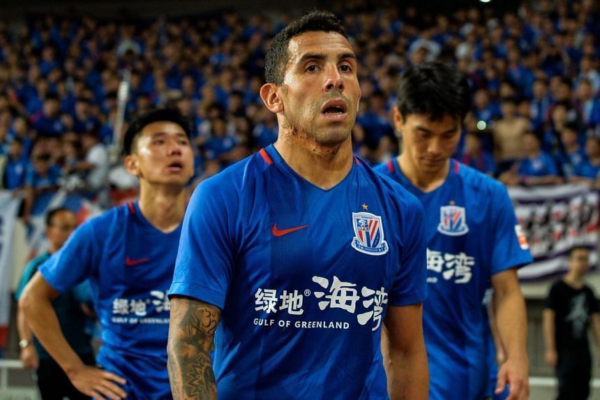 This file picture taken on Sept 16, 2017 shows Shanghai Shenhua's Carlos Tevez walking to the stands after his team lost their Chinese Super League football match to Shanghai SIPG.