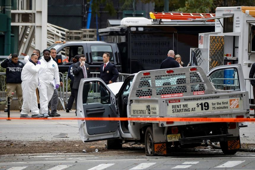 Law enforcement officials investigate a pickup truck used in an attack on the West Side Highway in lower Manhattan in New York City on Nov 1, 2017.