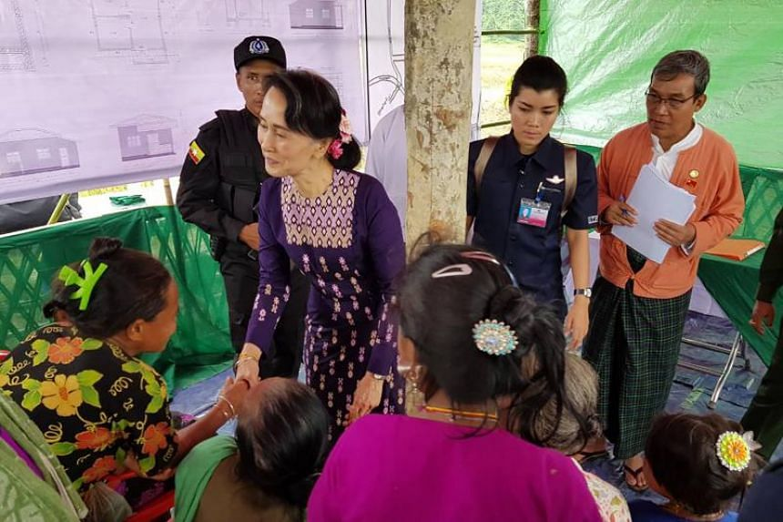 Myanmar State Counsellor Aung San Suu Kyi (centre L) meets with Myo ethnic people in northern Maungdaw, Myanmar's Rakhine State on November 2, 2017. Myanmar's leader Aung San Suu Kyi arrived on her first visit to conflict-battered northern Rakhine S