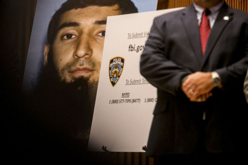 A photo of Sayfullo Saipov is displayed at a news conference.