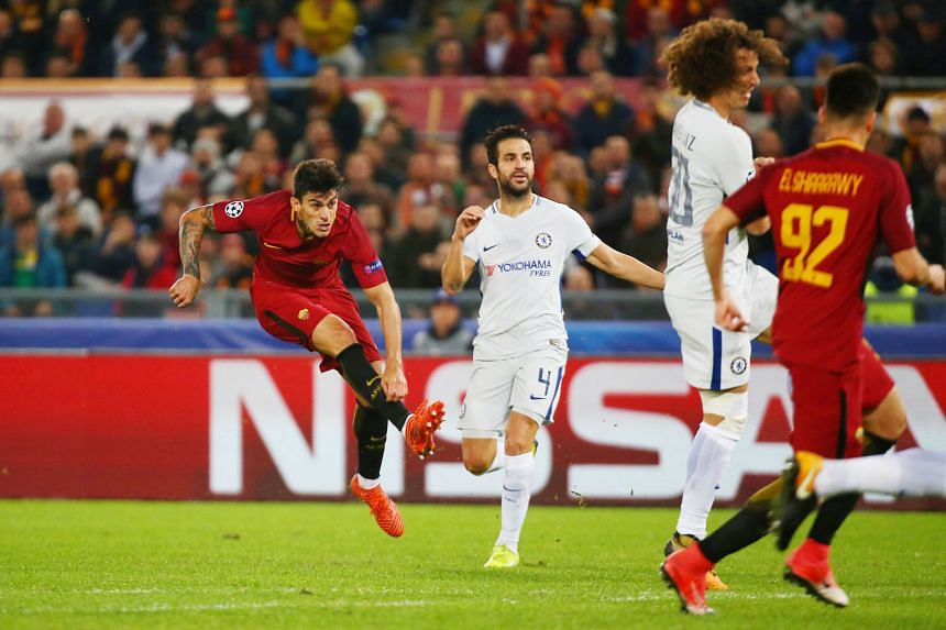Diego Perotti firing in Roma's third goal past Chelsea's Cesc Fabregas and David Luiz on Tuesday. Despite their travails, the Blues still look likely to move into the Champions League knockout phase as Spanish side Atletico are in even bigger trouble
