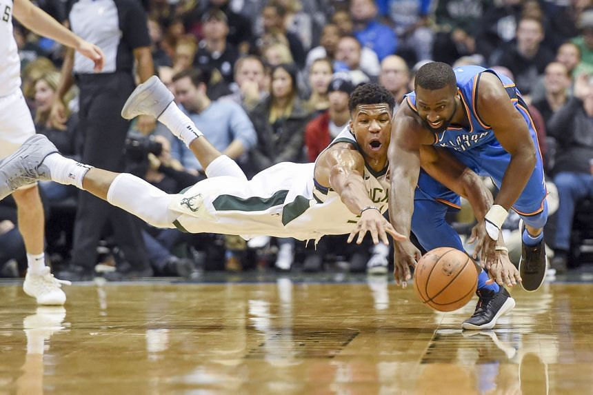 Bucks forward Giannis Antetokounmpo (left) and Thunder guard Raymond Felton battling for a loose ball. While Antetokounmpo outscored MVP Russell Westbrook, his team lost 91-110 as the visitors' defence proved too good.