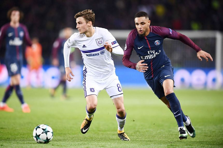 PSG left-back Layvin Kurzawa (right) outpacing Anderlecht midfielder Pieter Gerkens. He is the first defender to score a hat-trick in the Champions League.