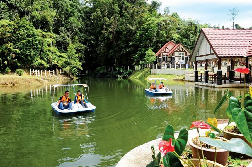 Tourists go on a boat ride on a lake on Fraser Hill in Pahang.