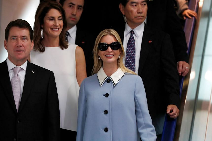 Ivanka Trump is escorted by US Ambassador to Japan William Hagerty and his wife Chrissy upon her arrival at Narita International Airport.
