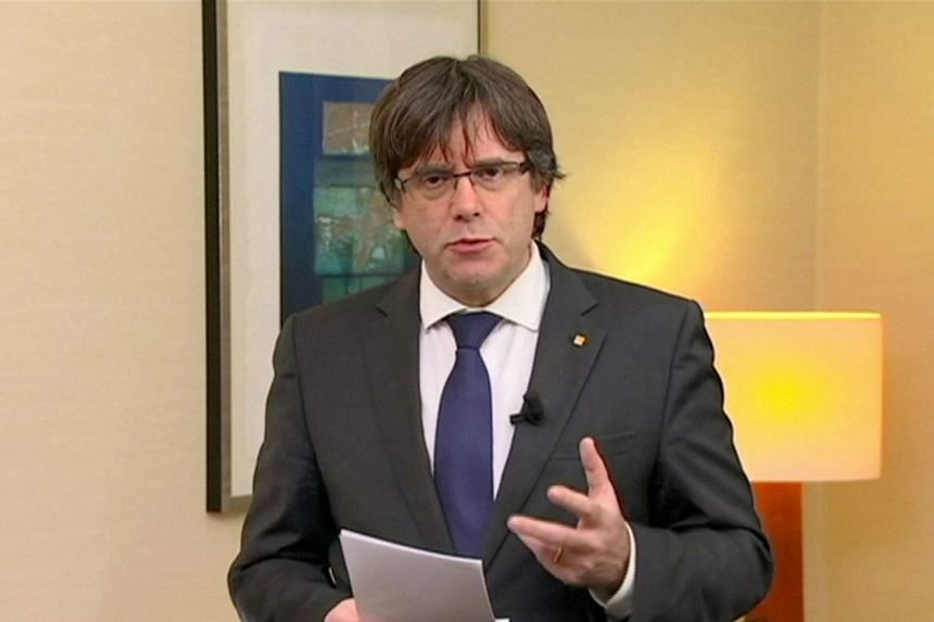 """Sacked Catalan President Carles Puigdemont makes a statement in this still image from a video calling for the release of """"the legitimate government of Catalonia"""", after a Spanish judge ordered nine Catalan secessionist leaders to be held in custody p"""