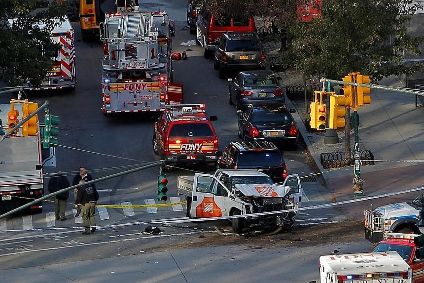 Emergency personnel at the scene of the deadly terror attack in New York that left eight people dead on Tuesday.