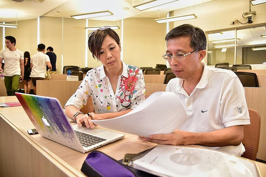 NUS alumni Genevieve Yeep, 47, and Lim Swee Hock, 54, are taking a business school module in personal finance and private wealth management at the university.