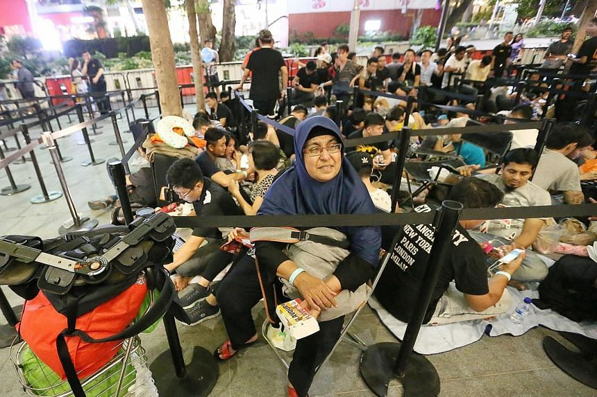 With the new iPhone X smartphone going on sale today at the Apple Store in Orchard, those hoping to land one did not waste time getting in line. 	First in the queue was Madam Ila Ahmad. The 52-year-old housewife, armed with Milo, mineral water, bread