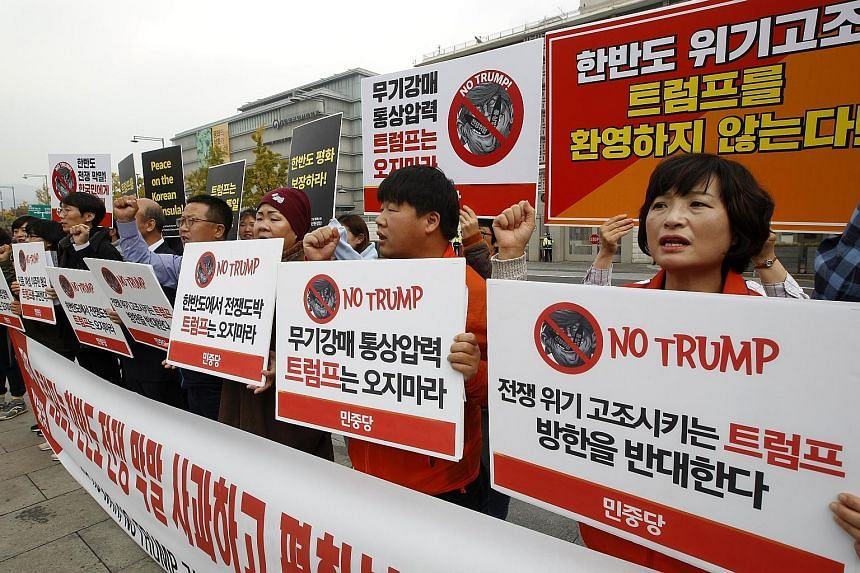 Demonstrators protesting against US President Donald Trump's visit to South Korea. China's move to settle the dispute with South Korea could scramble Mr Trump's calculations about how to deal with allies and North Korea.