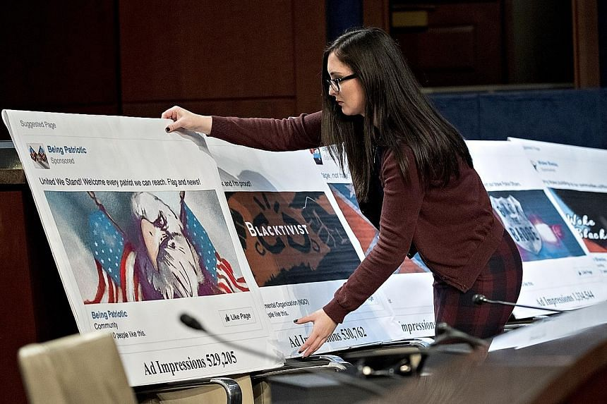 A display showing a social media post for an ad being set up during a House Intelligence Committee hearing in Washington on Wednesday.