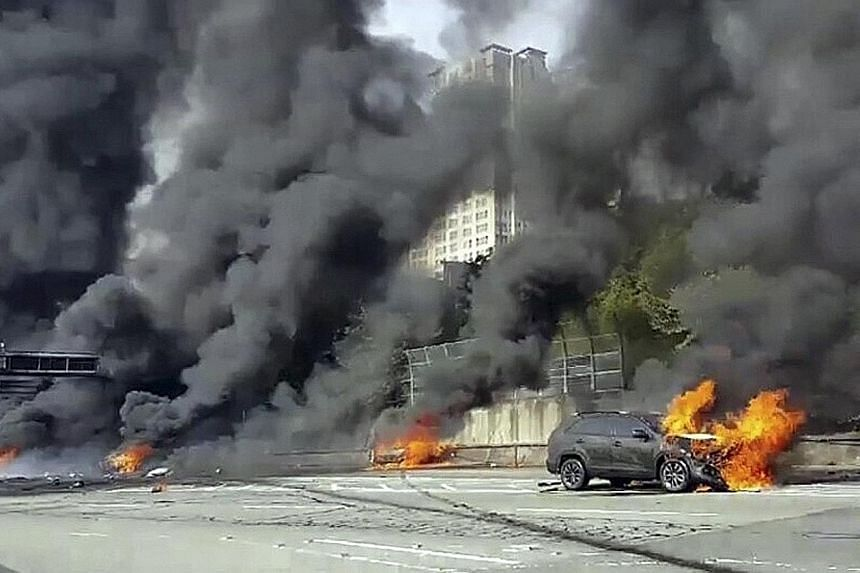 A motorway in Changwon, South Korea, was engulfed in smoke and flames following the crash and explosion of an oil tanker yesterday. The 2.5-tonne truck, which was carrying 30 drums of lubricant, had hit the median strip and overturned before catching