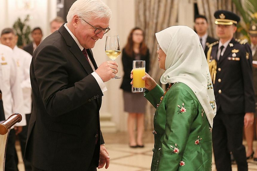 President Halimah Yacob with German President Frank-Walter Steinmeier at the Istana yesterday. Dr Steinmeier is in Singapore for a two-day state visit - the first by a German head of state - that ends today.