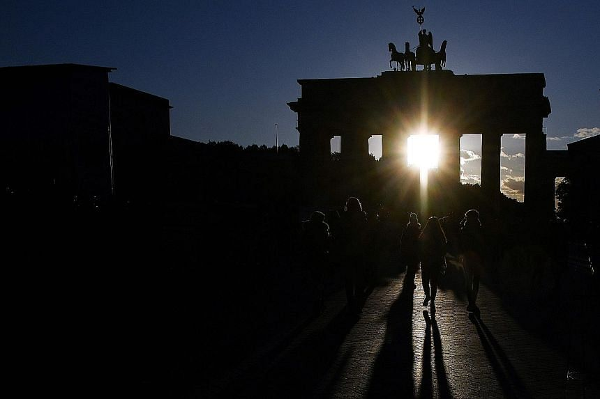 """Berlin's Brandenburg Gate. German President Frank-Walter Steinmeier noted that both Germany and Singapore believe in the benefits of an open and interconnected world, rather than a """"small-island mentality""""."""