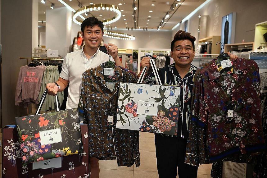Mr Afif Barker (left) spent $785 on his purchases, while Mr Diniy D. Hamzah spent $512 on his. By 8am yesterday, there were 120 people in line at H&M's Orchard Building outlet.
