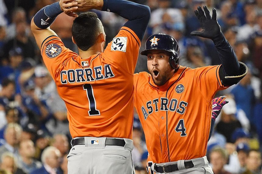 Above: Carlos Correa with Daniella Rodriguez. She accepted his on-field proposal in front of millions of TV viewers, moments after the Houston Astros had clinched the World Series for the first time. Houston Astros player George Springer celebrates w