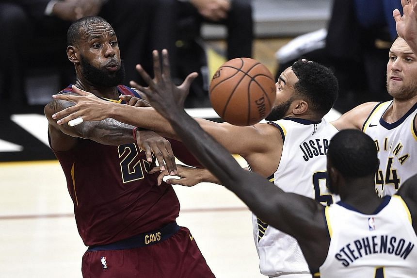 Cleveland forward LeBron James making a pass as Indiana players Cory Joseph, Lance Stephenson and Bojan Bogdanovic attempt to block him in their game at Quicken Loans Arena. He led the Cavs with 33 points and 11 assists but committed a game-high eig