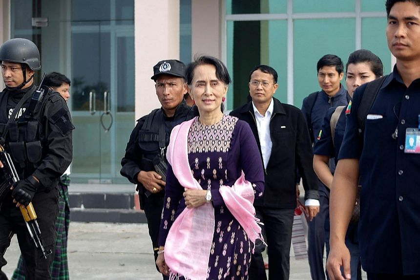 Ms Aung San Suu Kyi arriving at Sittwe airport for an unannounced visit to Rakhine state yesterday. She met Muslim religious leaders in the town of Maungdaw, one of the districts worst hit by the violence.