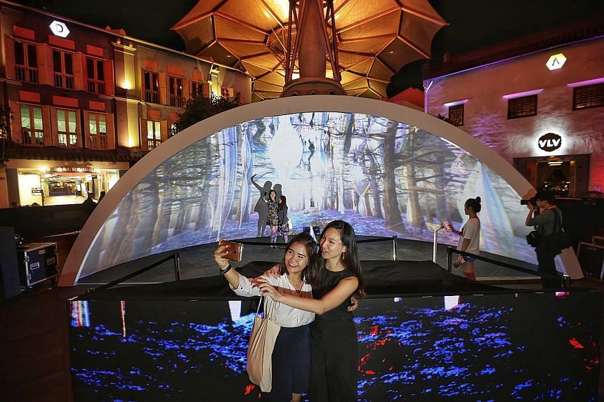 This year's Singapore River Festival will feature a Lit Up Party, an outdoor light-projection rave in Clarke Quay. The festival, which starts today and runs until tomorrow evening, involves more than 100 businesses in the area and is expected to draw