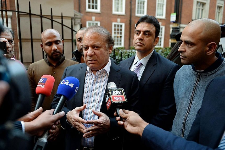 Nawaz Sharif (centre) talking to reporters on Wednesday in London, where he had gone for his wife's cancer treatment. The case against him, linked to properties his family owns in the city, could see him jailed.