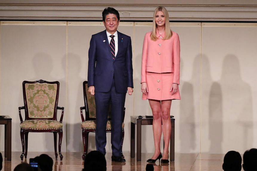 Ivanka Trump, daughter and assistant to US President Donald Trump, and Japanese Prime Minister Shinzo Abe attend the World Assembly for Women (WAW!) in Tokyo on Nov 3, 2017.
