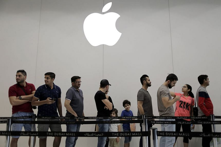 Customers queue outside an Apple store during the launch of the new iPhone X at Dubai Mall in Dubai on Nov 3, 2017.