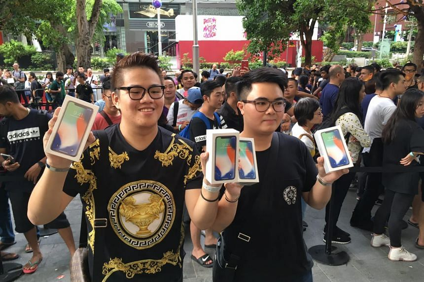 Supakorn Rieksiri (right), 22, a student from Thammasat University, was the first to get his hands on the new iPhone X. His friend Kittiwat Wang, 22, from Mahidol University International College, was the second.